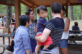 Child being held by parents